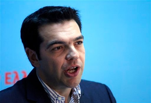 Alexis Tsipras, the leader of Greece's Radical Left Coalition party (SYRIZA) delivers a statement at the party's headquarters in Athens, Monday, May 7, 2012. Left-wing Greek election runner-up Tsipras rejected forming a coalition with the winning conserva