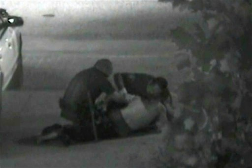 This still photo taken from a security camera released on Monday May 7,2012 by the Orange County District Attorney shows an altercation between Fullerton police officers and homeless Kelly Thomas at the Fullerton bus depot on July 5,2011.