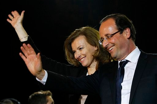 French president-elect Francois Hollande and his companion Valerie Trierweiler wave to supporters after greeting crowds gathered to celebrate his election victory in Bastille Square in Paris, France, Sunday, May 6, 2012.  (AP Photo/Francois Mori)
