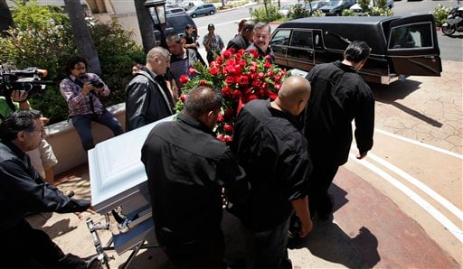 In this June 19,2010 file photo showing relatives and friends of Anastasio Hernandez carrying a casket out of a church after funeral services in San Diego.