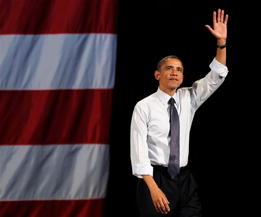 President Barack Obama waves as he leaves the stage after speaking at a fundraising event Thursday, May 10, 2012, in Seattle. (AP Photo/Elaine Thompson)