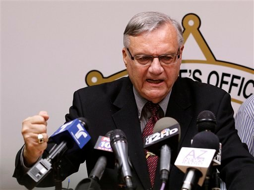 A defiant Maricopa County Sheriff Joe Arpaio, pounds his fist on the podium as he answers questions regarding the Department of Justice announcing a federal civil lawsuit against Sheriff Arpaio and his department, during a news conference May 10.