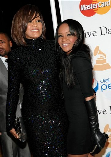 FILE - In this Feb. 12, 2011 file photo, singer Whitney Houston, left, and her daughter Bobbi Kristina arrive at the Pre-Grammy Gala & Salute to Industry Icons with Clive Davis honoring David Geffen in Beverly Hills, Calif.