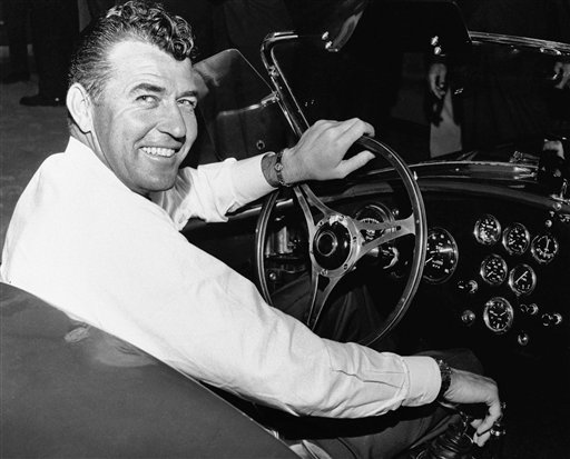FILE - In this 1964 file photo, auto racer Carroll Shelby, sits in a car. Shelby, the legendary race driver and Shelby Cobra sports car designer, has died at age 89. (AP Photo, File)