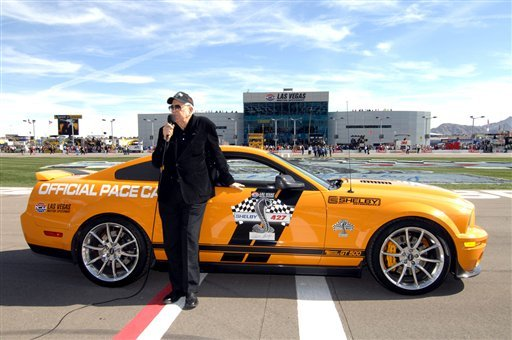 In this March 1, 2009, photo provided by the Las Vegas News Bureau, Carroll Shelby gives the command to start the NASCAR Sprint Cup Series, Shelby 427 race at the Las Vegas Motor Speedway in Las Vegas. (AP)