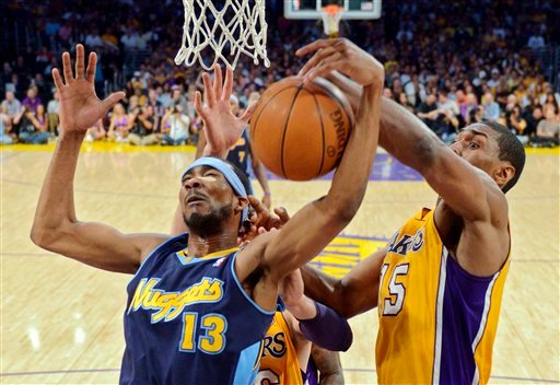 Denver Nuggets forward Corey Brewer, left, and Los Angeles Lakers forward Metta World Peace grapple for the ball during the first half of Game 7 in their first-round NBA basketball playoff series May 12, 2012, in Los Angeles. (AP Photo/Mark J. Terrill)