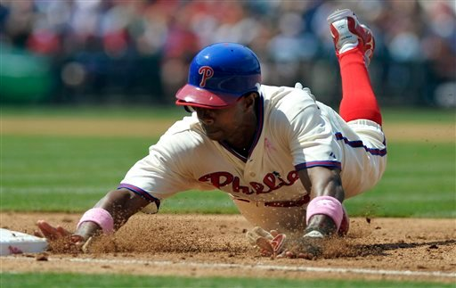 Philadelphia Phillies' Juan Pierre dives back to first base on a pickoff attempt by San Diego Padres pitcher Jeff Suppan during a baseball game, Sunday, May 13, 2012, in Philadelphia. The Phillies won 3-2. (AP Photo/The Express-Times, Matt Smith)