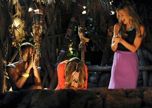 "In this photo provided by CBS Entertainment, ""Survivor: One World"" contestants Kim Spradlin, center, Chelsea Meissner, right, and Sabrina Thompson react after Spradlin is crowned sole survivor during the live reunion show in New York, Sunday, May 13."