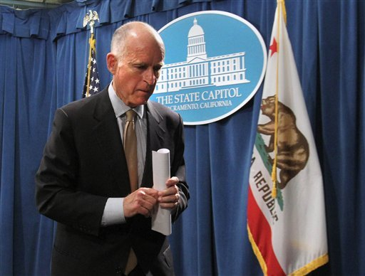Gov. Jerry Brown leaves a news conference after he unveiled his revised state budget plan at the Capitol in Sacramento, Calif., Monday, May 14, 2012. (AP Photo/Rich Pedroncelli)