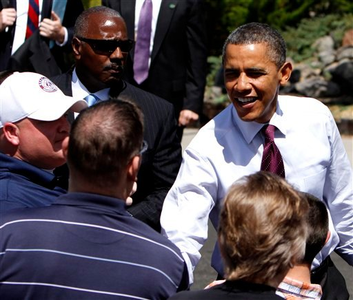 President Barack Obama visits with the crowd during his visit to the home of Val and Paul Keller, in Reno, Nev., Friday, May 11, 2012. (AP Photo/Rich Pedroncelli)