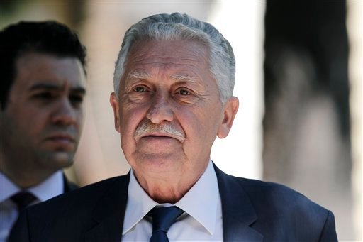 Greek leader of the Left Democratic party (DIMAR) Fotis Kouvelis leaves the Presidential Palace in Athens, after a meeting with Political party leaders, on Tuesday, May 15, 2012. (AP)