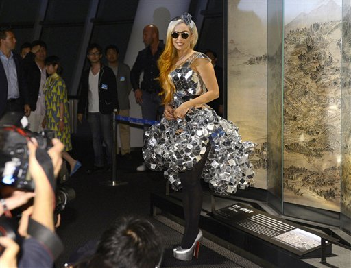 Lady Gaga poses as she visits the Tokyo Sky Tree, the world's tallest freestanding broadcast structure that stands 634-meter (2,080 feet), in Tokyo Tuesday, May 15, 2012.