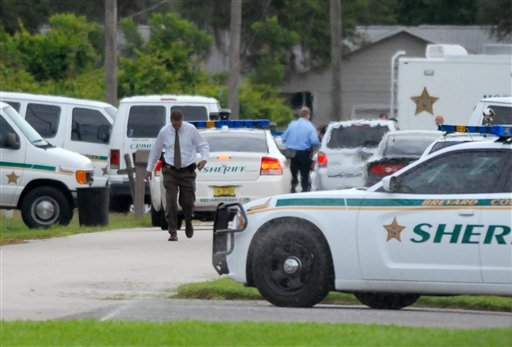 Emergency personell surround the scene of a multiple shooting in Port St. John, Brevard County, Fla., Tuesday, May 15, 2012. (AP Photo/Florida Today,Tim Shortt)