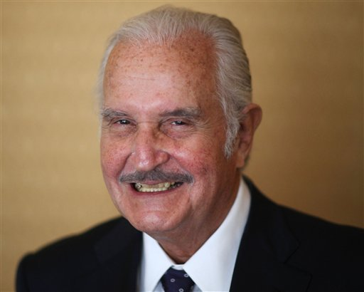 FILE - In this March 12, 2012 file photo, Mexican author Carlos Fuentes poses for a photo after a press conference in Mexico City. (AP Photo)
