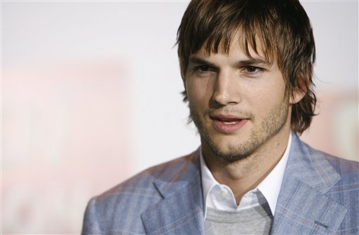 """FILE - Actor Ashton Kutcher poses for photographers at the premiere of """"Open Season"""" in Los Angeles, in this Sept. 25, 2006 file photo."""