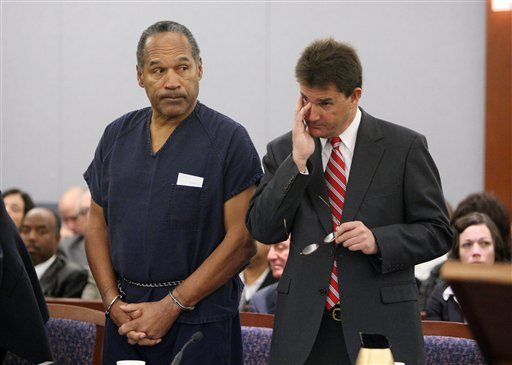 In this Dec. 5, 2008, file photo, O.J. Simpson, left, and his lawyer Yale Galanter appear during his sentencing hearing at the Clark County Regional Justice Center in Las Vegas.