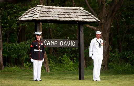 FILE - In this June 26, 2008 file photo, members of an honor guard stand at attention at Camp David, Md. Thursday, June 26, 2008. (AP Photo/Pablo Martinez Monsivais, File)