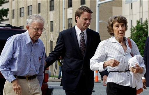 John Edwards, center, and his mother Bobbie Edwards, right, and his father Wallace Edwards, left, arrive at a federal courthouse for John Edwards' trial on charges of campaign corruption in Greensboro, N.C., Wednesday, May 16, 2012.(AP Photo/Chuck Burton)