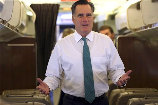 Republican presidential candidate, former Massachusetts Gov. Mitt Romney gestures as he speaks to reporters while boarding a charter flight in Miami, Fla., Thursday, May 17, 2012. (AP Photo/Mary Altaffer)