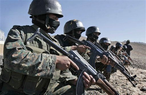 FILE - In this Wednesday, Jan. 6, 2010 file photo, an anti-terrorist unit from the Central Security Forces of the Ministry of Interior trains in the Sarif area on the eastern outskirts of the capital Sana, in Yemen. (AP Photo, File)