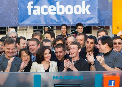 In this image provided by Facebook, Facebook founder, Chairman and CEO Mark Zuckerberg, center, applauds at the opening bell of the Nasdaq stock market, Friday, May 18, 2012, from Facebook headquarters in Menlo Park, Calif.