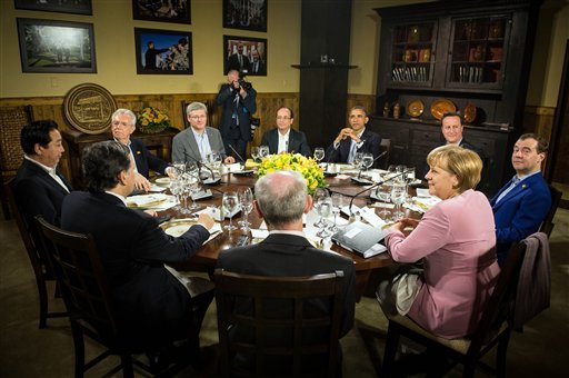 US President Barack Obama, fourth right, and clockwise: British Prime Minister David Cameron, the Russian Prime Minister Dmitri Medvedev German chancellor Angela Merkel, European Council President Herman Van Rompuy, the President of the European Commissio