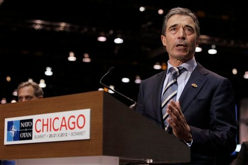 NATO Secretary General Anders Fogh Rasmussen speaks to the media before state and government leaders arrive at the NATO Summit in Chicago Sunday, May 20, 2012. (AP Photo/Carolyn Kaster)