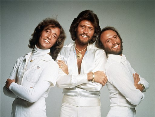 In this January 1979 file photo, the British pop group the Bee Gees, from left, Robin Gibb, Barry Gibb and Maurice Gibb, pose for photographers, somewhere in England. A representative said on Sunday, May 20, 2012, that Robin Gibb has died. He was 62. (AP