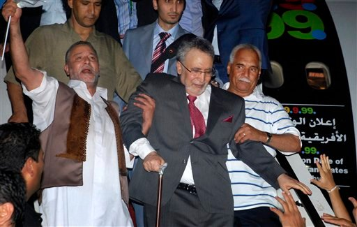 This Thursday, Aug. 20, 2009 file photo shows Libyan Abdel Baset al-Megrahi, who was found guilty of the 1988 Lockerbie bombing, center, being helped down the airplane steps on his arrival at an airport in Tripoli, Libya. (AP)
