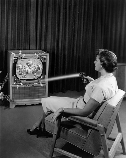 """This 1955 photo illustration provided by LG Electronics, shows an ad for a Zenith """"Flash-Matic,"""" the first wireless TV remote control."""