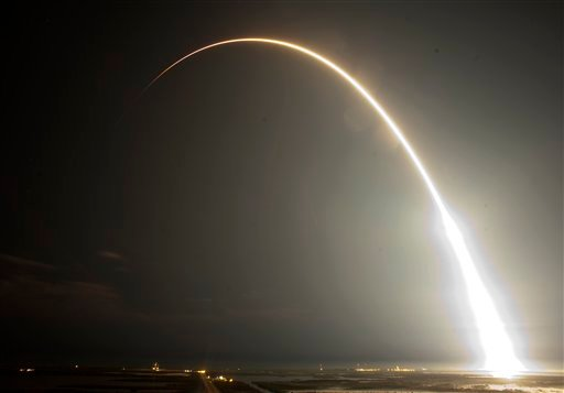 The Falcon 9 SpaceX rocket is seen during a time exsposure as it lifts off from space launch complex 40 at the Cape Canaveral Air Force Station in Cape Canaveral, Fla., early Tuesday, May 22, 2012. (AP Photo/John Raoux)