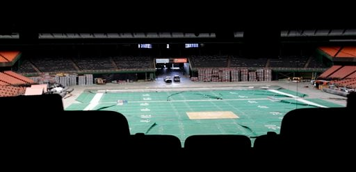 Old, wrinkled Astroturf for football lays across the floor of the Astrodome Monday, May 21, 2012, in Houston.