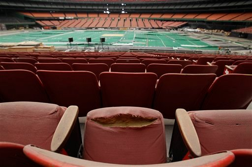 Rows of dirty, tattered seats ring the Astrodome Monday, May 21, 2012, in Houston.