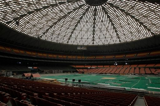 Once touted as the Eighth Wonder of the World, the Astrodome sits quietly gathering dust and items for storage Monday, May 21, 2012, in Houston.