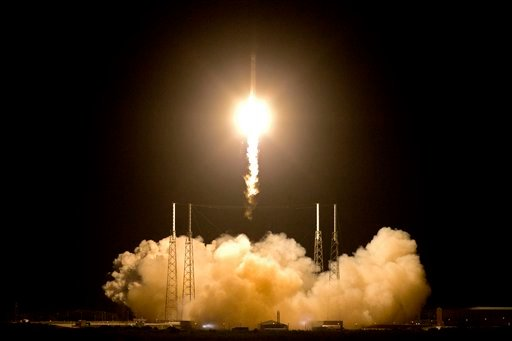 FILE - In this Tuesday, May 22, 2012 file photo, the SpaceX Falcon 9 rocket lifts off from space launch complex 40 at the Cape Canaveral Air Force Station in Cape Canaveral, Fla. (AP Photo/John Raoux)