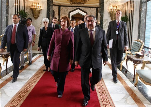 Iraq's Foreign Minister Hoshyar Zebari, 2nd right, walks with the EU foreign policy chief Catherine Ashton upon her arrival at Baghdad International Airport in Iraq, Wednesday, May 23, 2012. (AP Photo/Mohammed Ameen, Pool)