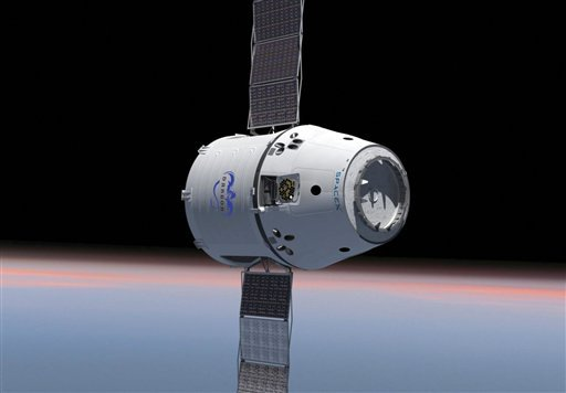 This computer generated image provided by SpaceX shows their Dragon spacecraft with solar panels deployed. (AP Photo/SpaceX)