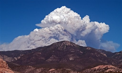 This Tuesday, May 22, 2012, photo, provided by David Thornburg shows a plume of smoke rising from the Whitewater fire burning in the Gila Wilderness east of Glenwood, N.M. (AP Photo/David Thornburg)