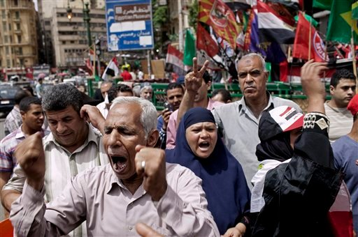 Egyptian demonstrators gather to denounce the electoral success of Ahmed Shafiq, a presidential candidate, in Tahrir Square in Cairo, Egypt on Friday, May 25, 2012. (AP Photo/Pete Muller)