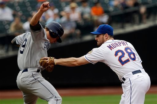 New York Mets second baseman Daniel Murphy (28) tags out San Diego Padres' Blake Tekotte (9) before throwing out Chris Denorfia for a double play during the ninth inning of a baseball game May 26, 2012, in New York. (AP Photo/Frank Franklin II)