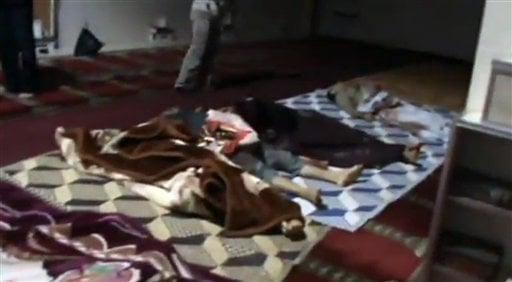 This image made from amateur video released by Shaam News Network and accessed Saturday, May 26, 2012 purports to show covered bodies after a government assault on Houla, Syria. (AP Photo/Shaam News Network via AP video)