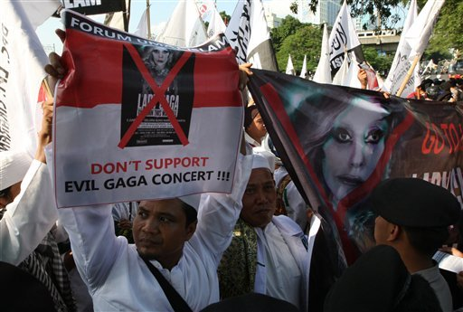Muslim men hold up banners during a rally against U.S. pop singer Lady Gaga's concert that is scheduled to be held on June 3, outside the U.S. Embassy in Jakarta, Indonesia May 25, 2012. (AP Photo/Dita Alangkara)