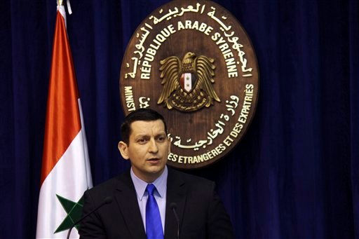 Syria's foreign ministry spokesman Jihad Makdissi speaks at a news conference in Damascus, Syria, Sunday, May 27, 2012. (AP Photo/Bassem Tellawi)