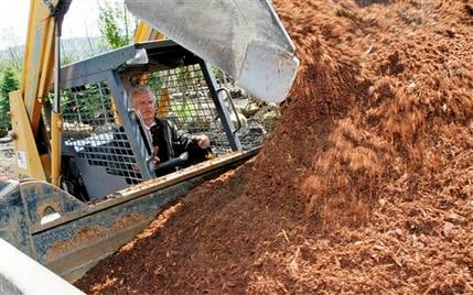 In this May 17, 2012 photo, Richard Lowe loads a truck with mulch in Morrisville, Vt. (AP Photo/Toby Talbot)