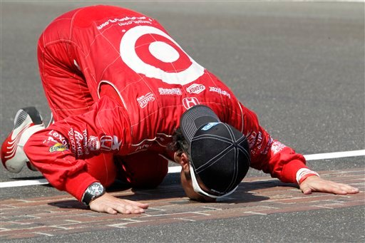 Dario Franchitti, of Scotland, kisses the start/finish line after winning IndyCar's Indianapolis 500 auto race at Indianapolis Motor Speedway in Indianapolis, Sunday, May 27, 2012. (AP Photo/Tom Strattman)