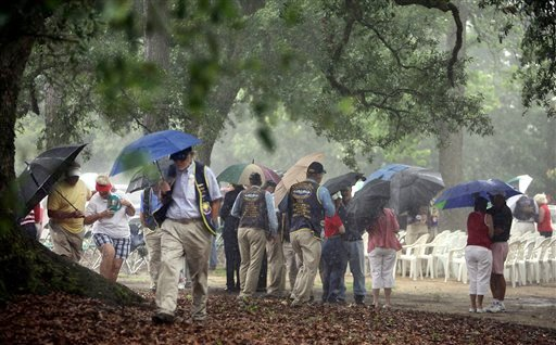 People attending the American Legion Post 21 Memorial Day observance head for cover when rain from outer bands of Tropical Depression Beryl passed through the Summerville, S.C., area May 28, 2012. (AP Photo/The Post and Courier, Brad Nettles)
