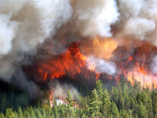In this Saturday, May 26, 2012 photo provided by the Michigan Department of Natural Resources, a wildfire burns in Michigan's Upper Peninsula. (AP Photo/Michigan Department of Natural Resources)