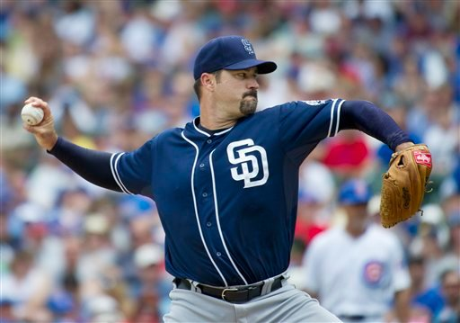 San Diego Padres starting pitcher Jeff Suppan delivers during the first inning of a baseball game against the Chicago Cubs, Monday, May 28, 2012 in Chicago. (AP Photo/Brian Kersey)