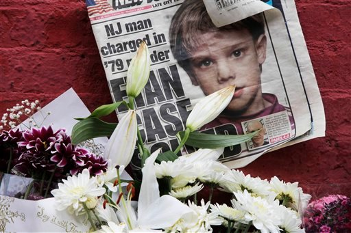 A newspaper with a photograph of Etan Patz is part of a makeshift memorial in the SoHo neighborhood of New York, Monday, May 28, 2012. (AP Photo/Mark Lennihan)