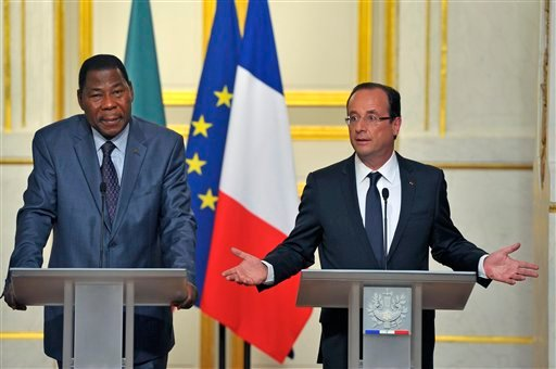 French President Francois Hollande addresses reporters during a joint press conference with Benin and African Union President Thomas Boni Yayi, left, at the Elysee Palace in Paris, Tuesday May 29, 2012. (AP Photo/Jacques Brinon)
